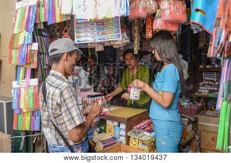 Yangon Myanmar - April 25 2016 : People buying goods in traditional burmese convenience store