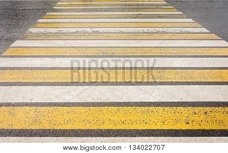 yellow and white pedestrian crossing close up
