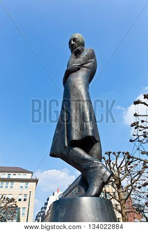 HAMBURG, GERMANY - JUNE 3, 2011: statue of famous German poet Heinrich Heine in Hamburg Germany at the townhall place. Heine worked in Hamburg 1825 as author with publisher Julius Campe
