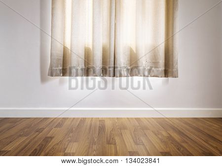 laminated wood floor with white wall, with curtain
