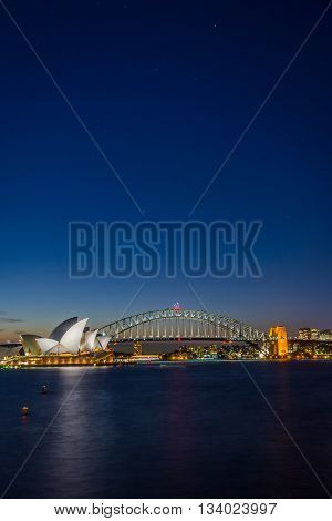 SYDNEY, AUSTRALIA - APRIL 20: View on Sydney opera and Harbour bridge at night long exposure, most recognicable australian landmarks. April 2016