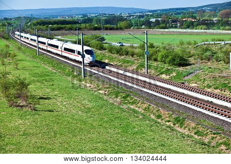 RAUNHEIM, GERMANY - June 3, 2011: high speed train with full speed in landscape