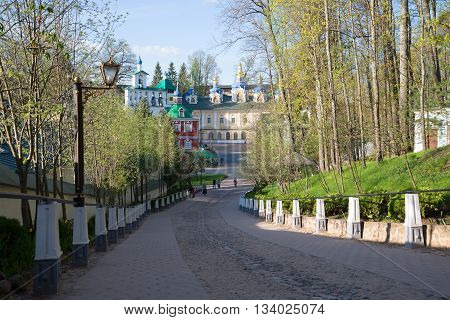 PSKOV REGION, RUSSIA - MAY 07, 2016: A sunny may morning at the Holy Dormition Pskovo-Pechora monastery. Main landmark of the city Pechory, Pskov region