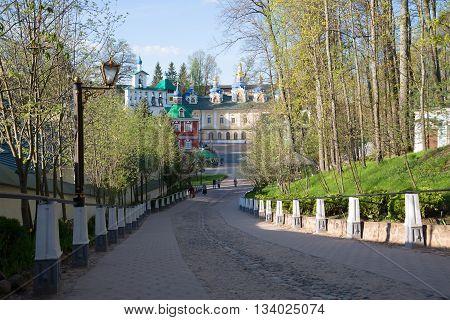 PSKOV REGION, RUSSIA - MAY 07, 2016: A sunny may morning at the Holy Dormition Pskovo-Pechora monastery. Main landmark of the city Pechory, Pskov region