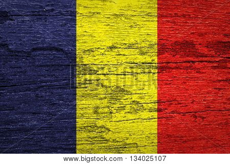 Grunge Chad Flag on wood texture background