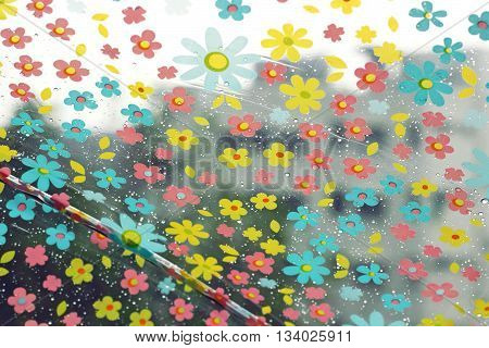 Rain Drops On Colorful Flower Umbrella For Bad Weather, Winter Or Protection