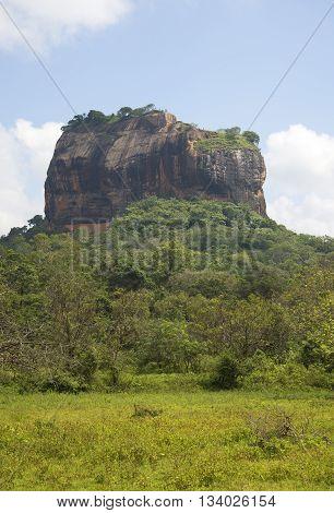 The Sigiriya mountain is a sunny day. Sri Lanka