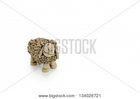 Sheep figure made of clay on a white background.