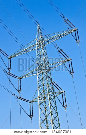 .electricity Tower With Power Lines Against A  Blue Sky .