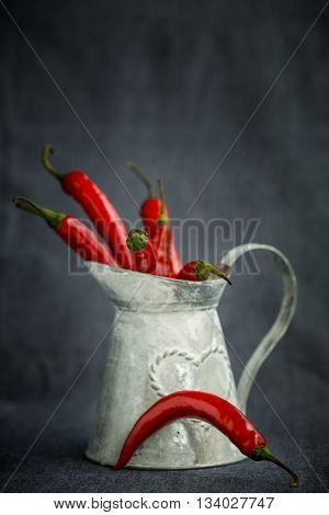 Hot red chili pepper in a metal gray basket