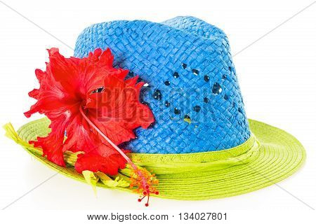 Blue and green summer panama straw hat with red hibiscus flower isolated on white