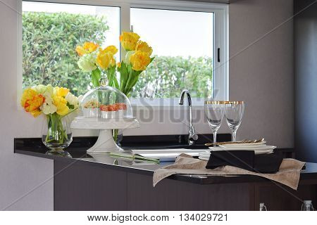 modern pantry with sink and utensil on granite counter top at home