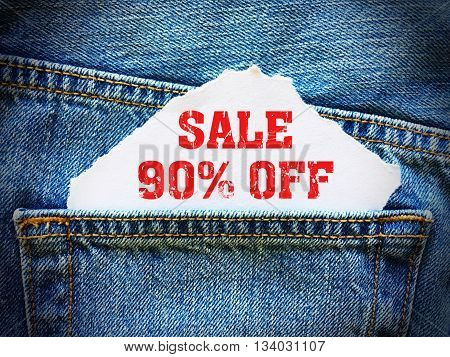 90% off on white paper in the pocket of blue denim jeans