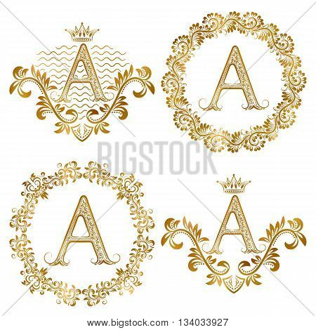 Golden letter A vintage monograms set. Heraldic monogram in coats of arms form letter A in floral round frame letter A in wreath heraldic monogram in floral decoration with crown.