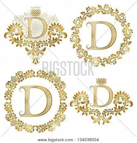 Golden letter D vintage monograms set. Heraldic monogram in coats of arms form letter D in floral round frame letter D in wreath heraldic monogram in floral decoration with crown.