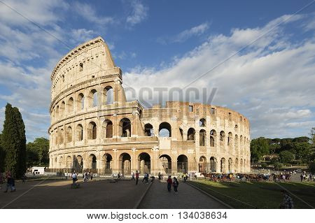 ROME - ITALY MAY 24 2016: Tourists visiting the Colosseum on may 10 2012. The Colosseum is an iconic symbol of Imperial Rome. It is one of Rome's most popular tourist attractions in Rome.
