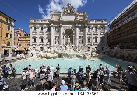 ROME ITALY - MAY 24 2016: Tourists visiting the Trevi Fountain. Trevi Fountain is an iconic symbol of Imperial Rome. It is one of Rome's most popular tourist attractions.