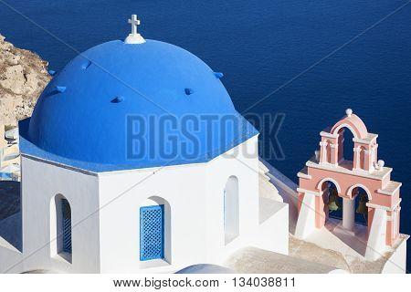 Santorini Greece. Traditional architecture church in Oia village landmark of Greek Islands Aegean Sea.