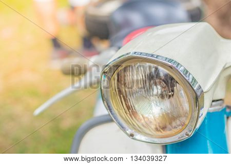 Front a headlight of a motorcycle creamy.