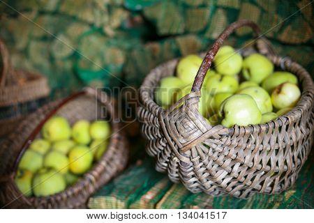 Wicker baskets full of fresh green apples