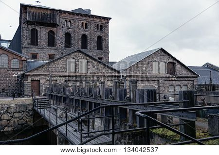 Old Swedish ironworks with water dam in front.