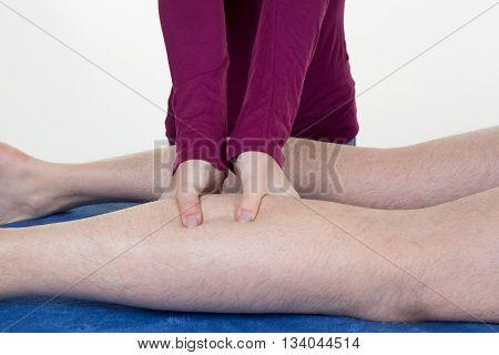 Hands Massaging Human Calf Muscle.therapist Applying Pressure On Female Calf
