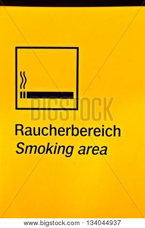 WIESBADEN, GERMANY - JUNE1, 2013: sign smoking area in a train station