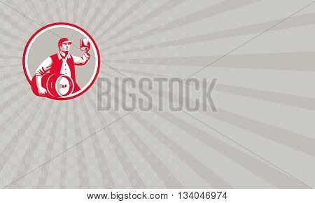 Business card showing illustration of an american worker wearing hat carrying keg on one hand and toasting beer mug on the other set inside circle on isolated background done in retro style.