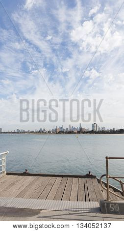 Melbourne - March 3 2016: View from a wooden jetty over the city of Melbourne with a berth in the Port Phillip Bay in Victoria March 3 2016 Melbourne Australia