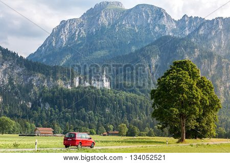 Beautiful summer romantic road view of the Neuschwanstein castle at Fussen Bavaria, Germany