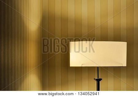 Lit floor lamp in a room