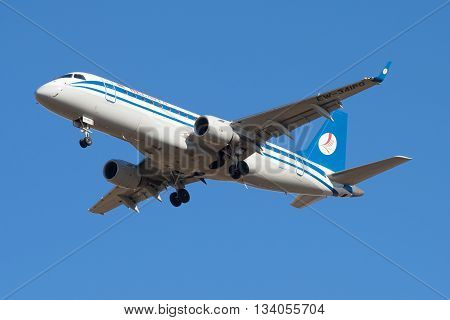 SAINT PETERSBURG, RUSSIA - MARCH 20, 2016: The Embraer ERJ-175LR (EW-341PO) of the company Belavia in flight closeup