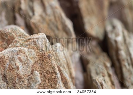 Close-up detail of rough cut miniature rocky cliffs. Nature and adventure concept.