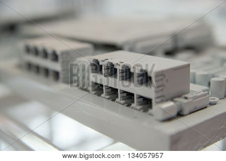 Close-up detail of ethernet ports (RJ45) spray-painted with white paint. Computer and internet concept.