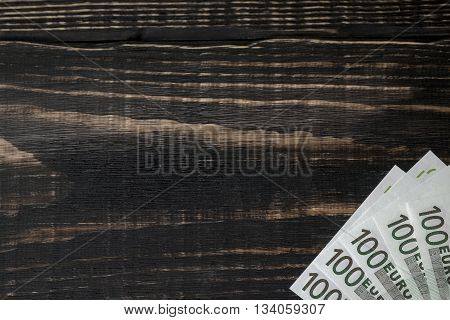 Euro Banknote On A Dark Wooden Background