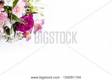 Summer bouquet from pink and purple gillyflowers and alstroemeria on white background