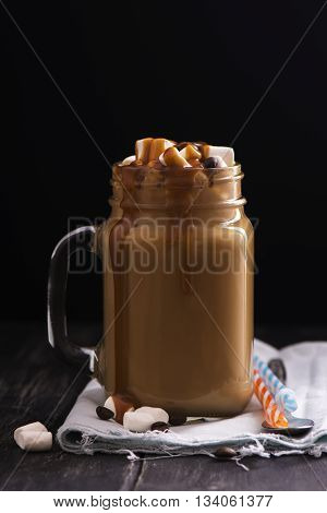 Caramel coffee with cream, marshmallows and syrup