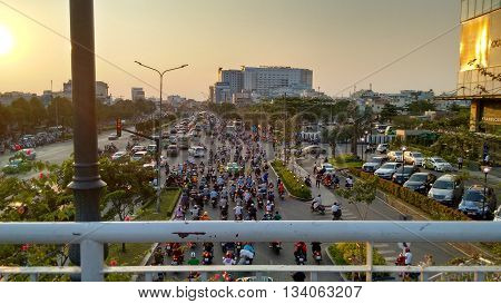 Ho-Chi-Minh-City (Saigon), Vietnam, 21st March 2016. Traffic jam at an intersection seen from a pedestrian bridge above. Every day's ritual on all main roads in that asian mega-city.