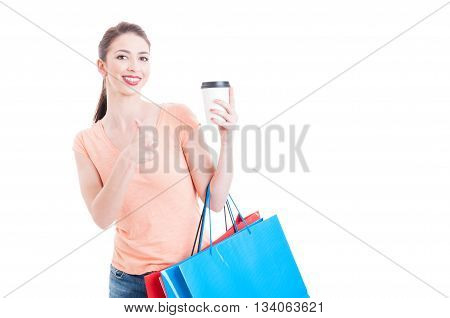 Shopping Woman Showing Thumb Up Gesture For Cup Of Coffee