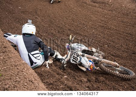 WorcesterUK-April 24 2016 :A competitor crashes while taking part in a Motocross race.Motocross is an extreme sport with venues in many countries around the world. This was a free event with no photography restrictions.