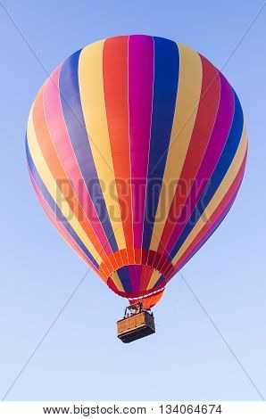 MULTI-COLORED BALLON IN THE BLUE SKY,  AEROSTAT