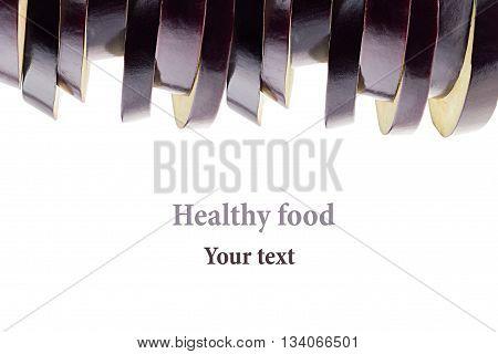 Pile of slices of eggplant on a white background. Fresh raw sliced eggplant. Isolated. Decorative frame border. Food background.