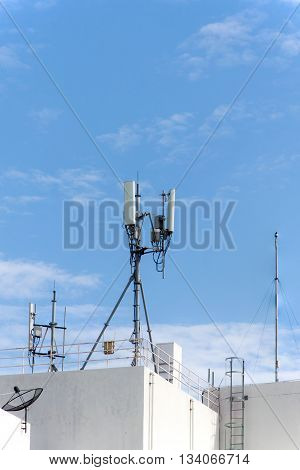 panel antenna mobile communication on background blue sky. telecommunications antenna tripod on the tower.