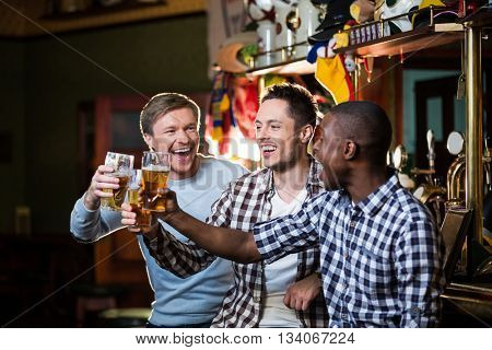 Smiling man with beer in pub