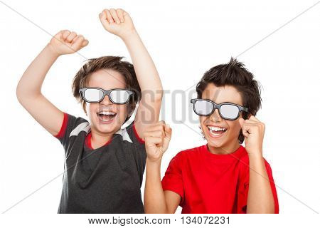 Portrait of a two happy boys wearing 3D glasses watching comedy movie and laughing, isolated on white background, cheerful friends enjoying good cinema