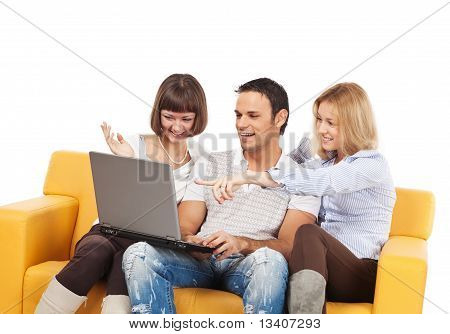 Amused Young People With Laptop Computer
