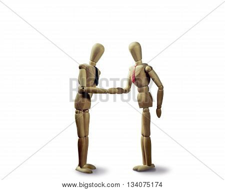 two puppets shakes hands at the conclusion of the deal on the white isolated background