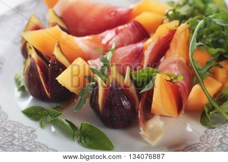 Prosciutto di Parma, italian cured ham with melon and figs