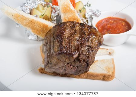 Prepared mignon steak served with croutons and sauce