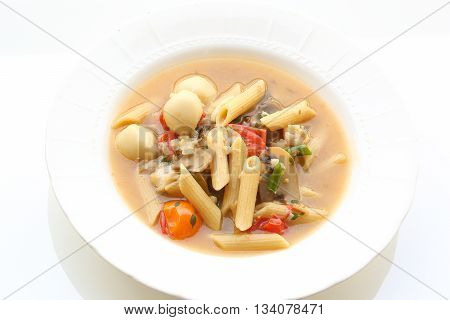 Wholegrain Pasta in Meatball soup with tomato and herb on white background